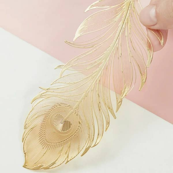 detail of golden laser cut metal feather