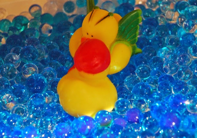 rubber ducks in water bead sensory bin