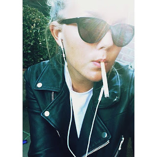 dangling cigarette in leather jacket