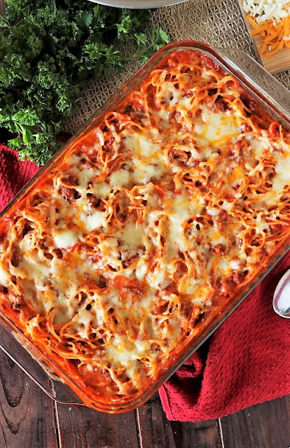 Pan of Baked Spaghetti Topped with Cheese Image