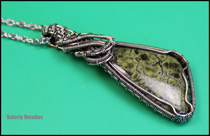 Pendant from wire nickel silver and cabochon from stone Serpentinit.