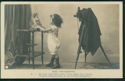 http://www.ebay.com/itm/Child-girl-Doll-Camera-photographer-original-old-1900s-Photo-postcard-ut20-/381671215766?hash=item58dd609296:g:XygAAOSwZQxW5LsW