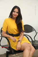 Actress Poojitha Stills in Yellow Short Dress at Darshakudu Movie Teaser Launch .COM 0294.JPG
