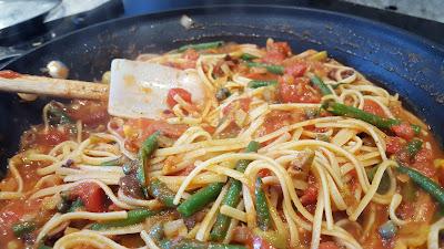 Swordfish Puttanesca cooking in the pan.