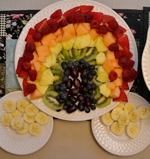 fruit salad shaped like a rainbow