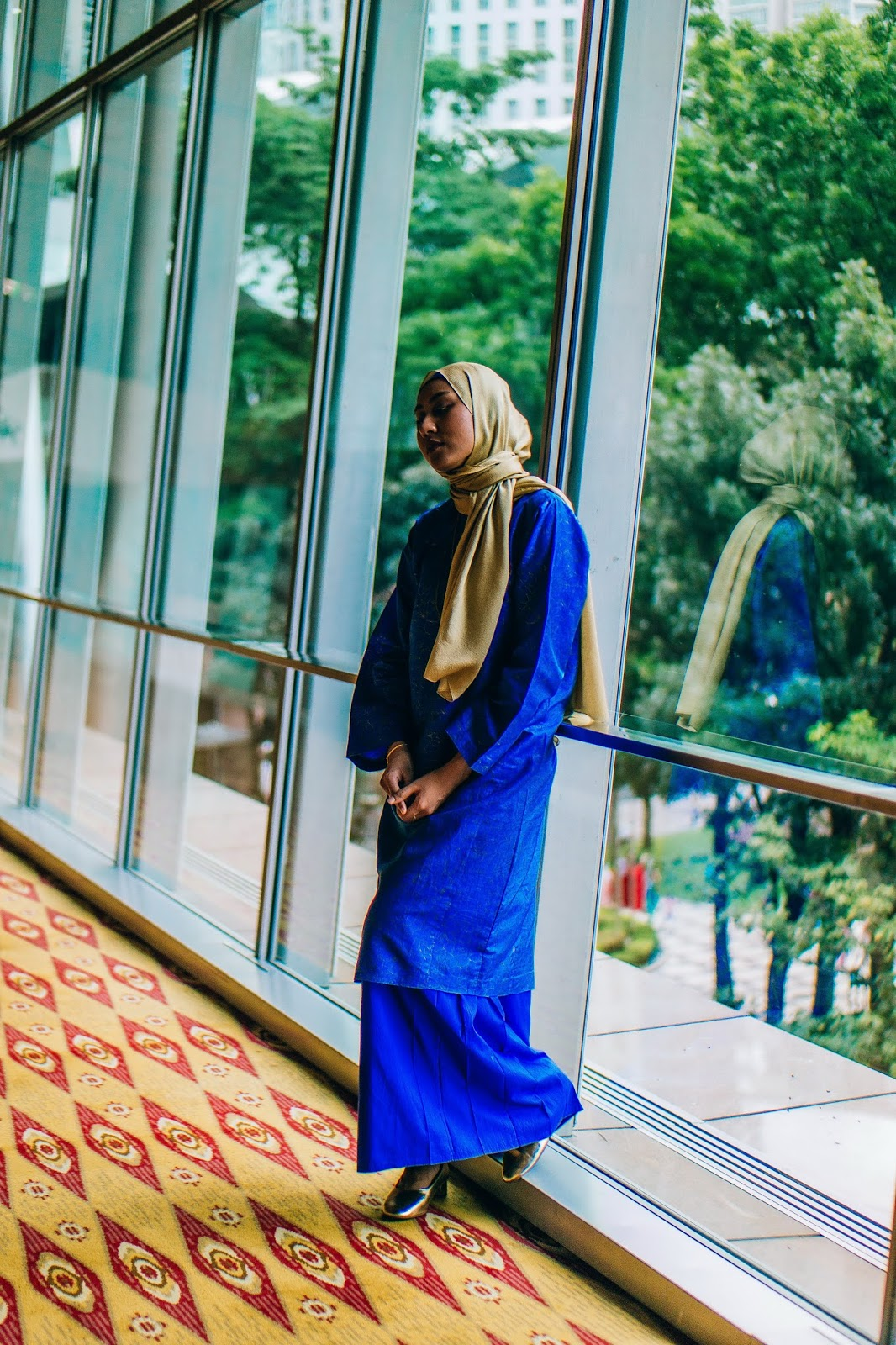 Electric blue traditional baju kurung Raya open house