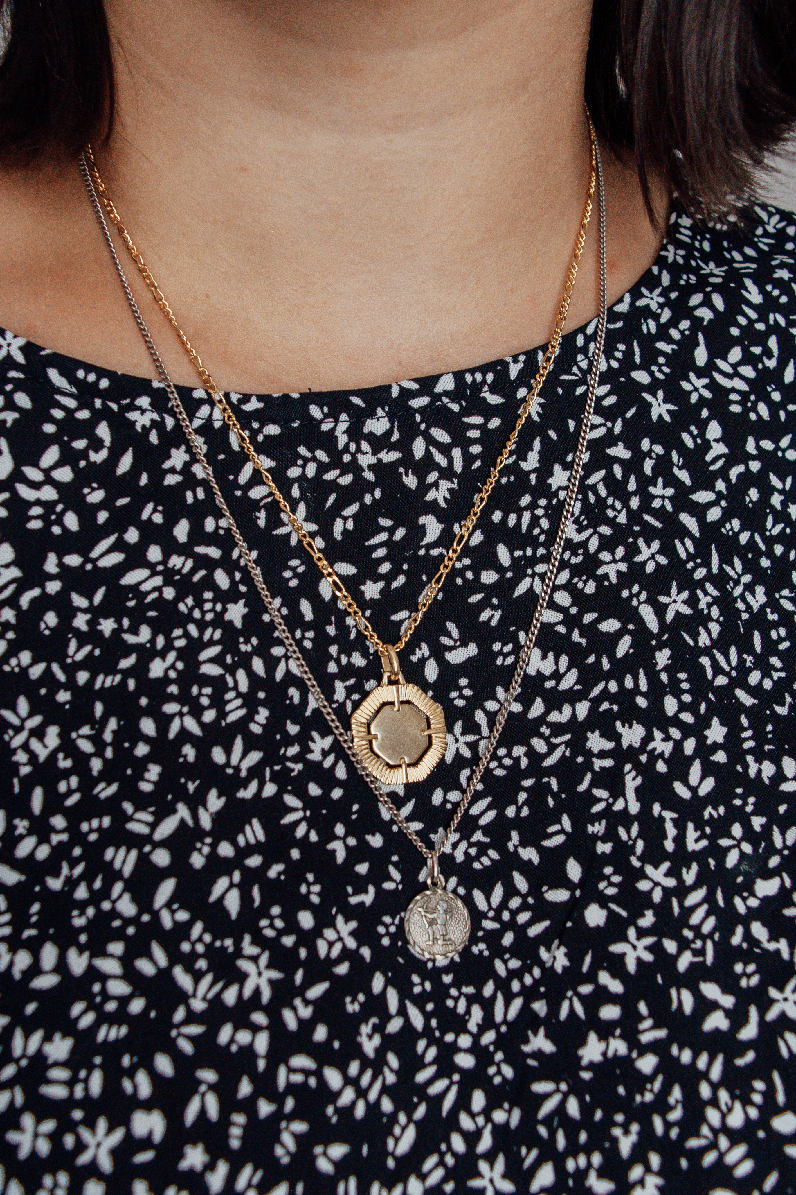 Layered gold and silver medallion necklaces
