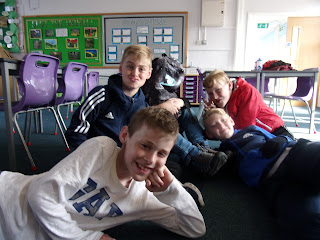 relaxed boys with classroom plastic chairs