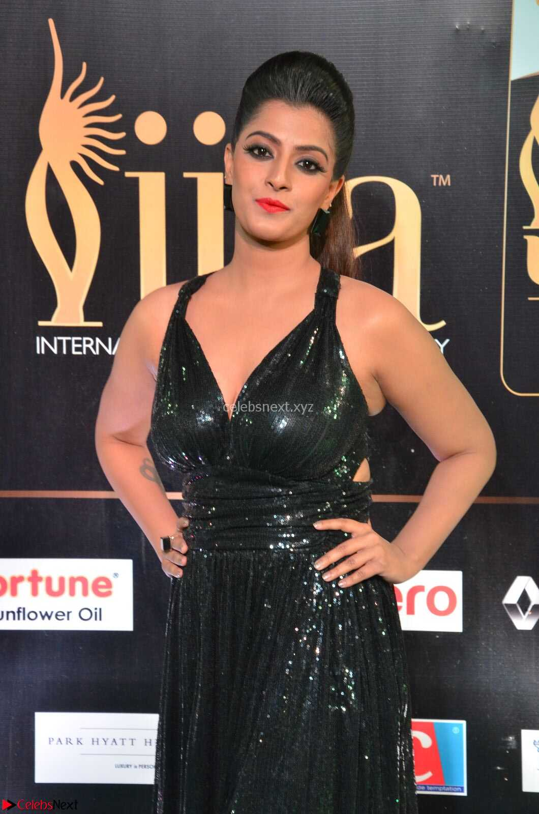 Varalaksmi in Green Glittering Sleeveless Backless Gown at IIFA Utsavam Awards 2017  Day 2 CelebsNext Exclusive