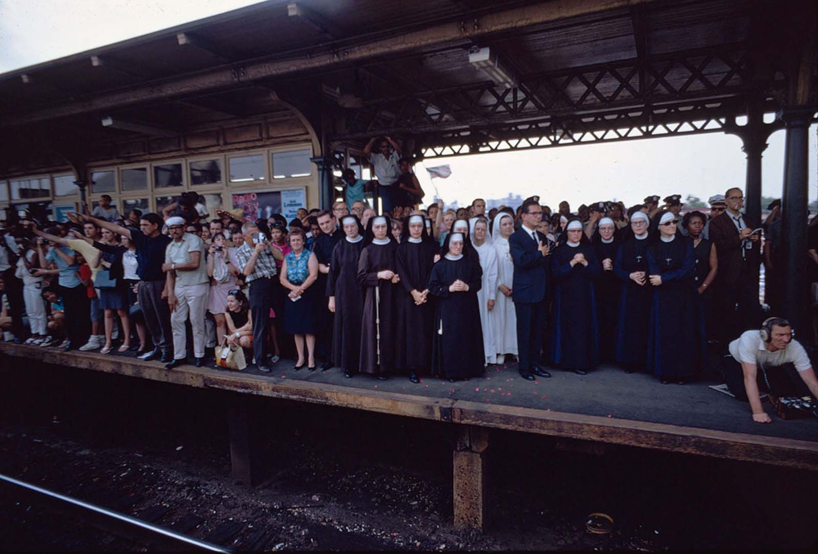 People fill North Philadelphia station as the train passes on June 8, 1968.