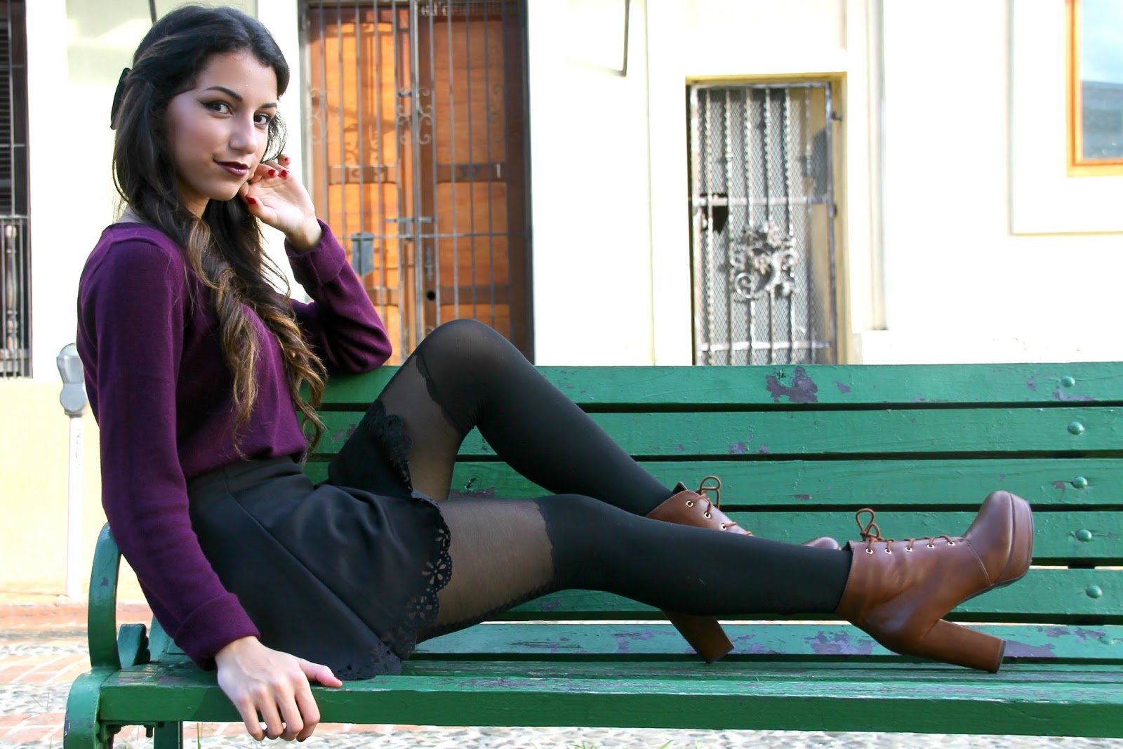 Girl sitting on a bench with a skirt fall lookbook