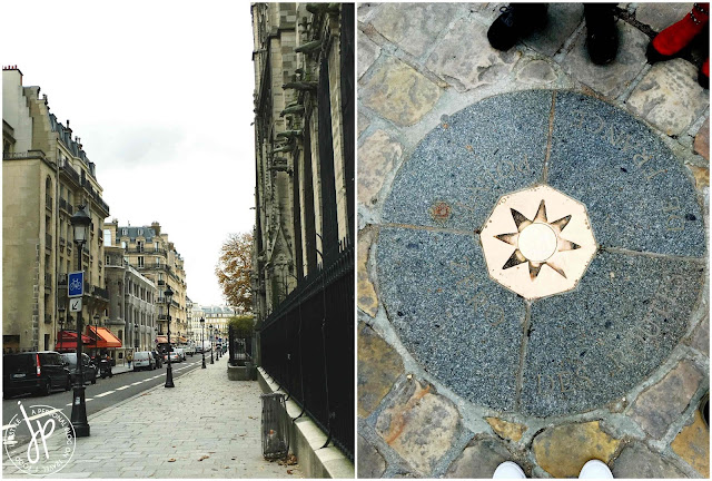 street in paris, bronze plaque on cobblestone