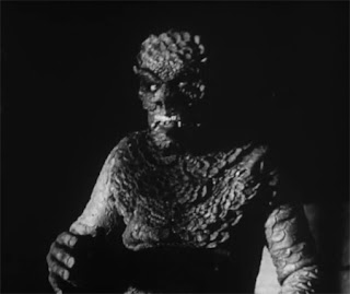 Robert Clarke in the full Sun Demon mask and suit