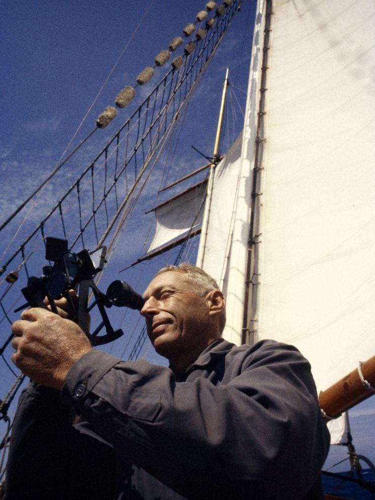 A sailor seaman seafarer using sextant