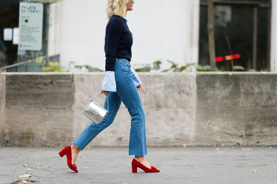 heeled loafers red with denim jeans black sweater street style chic
