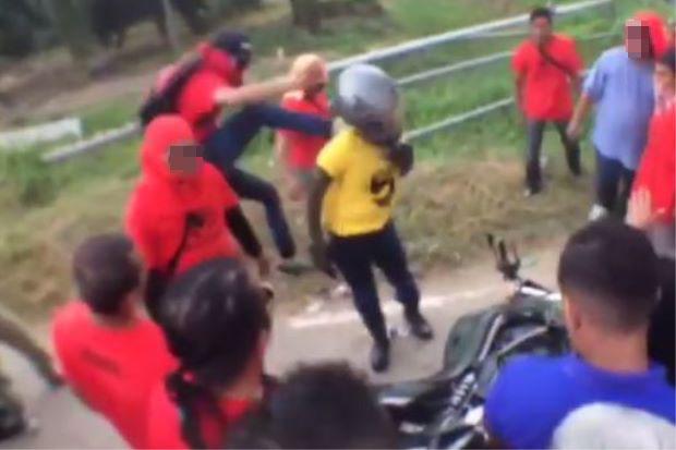 Polis Buru 'Samseng' Baju Merah