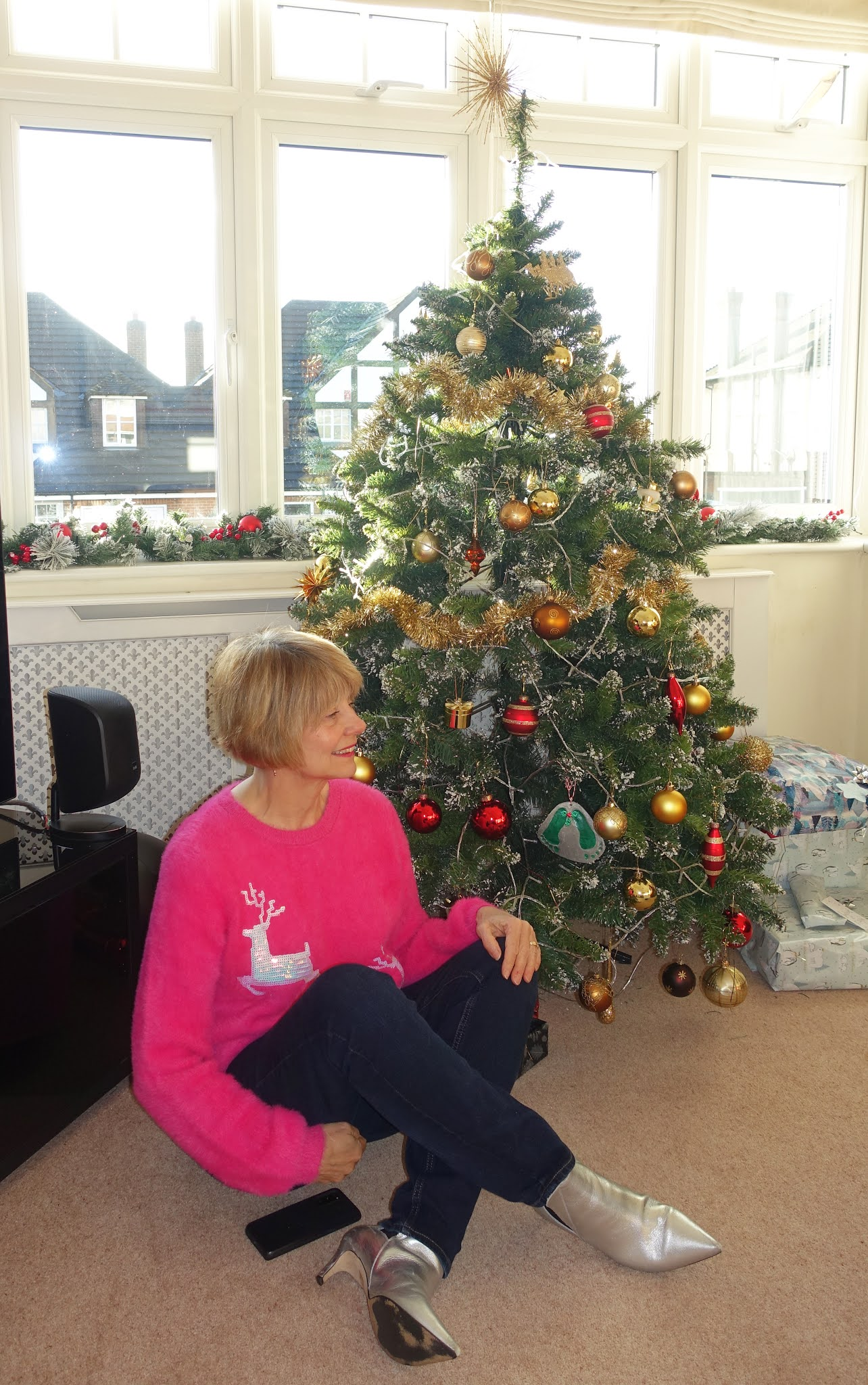 Seated vby the Christmas tree: Is This Mutton blogger Gail Hanlon in London, UK