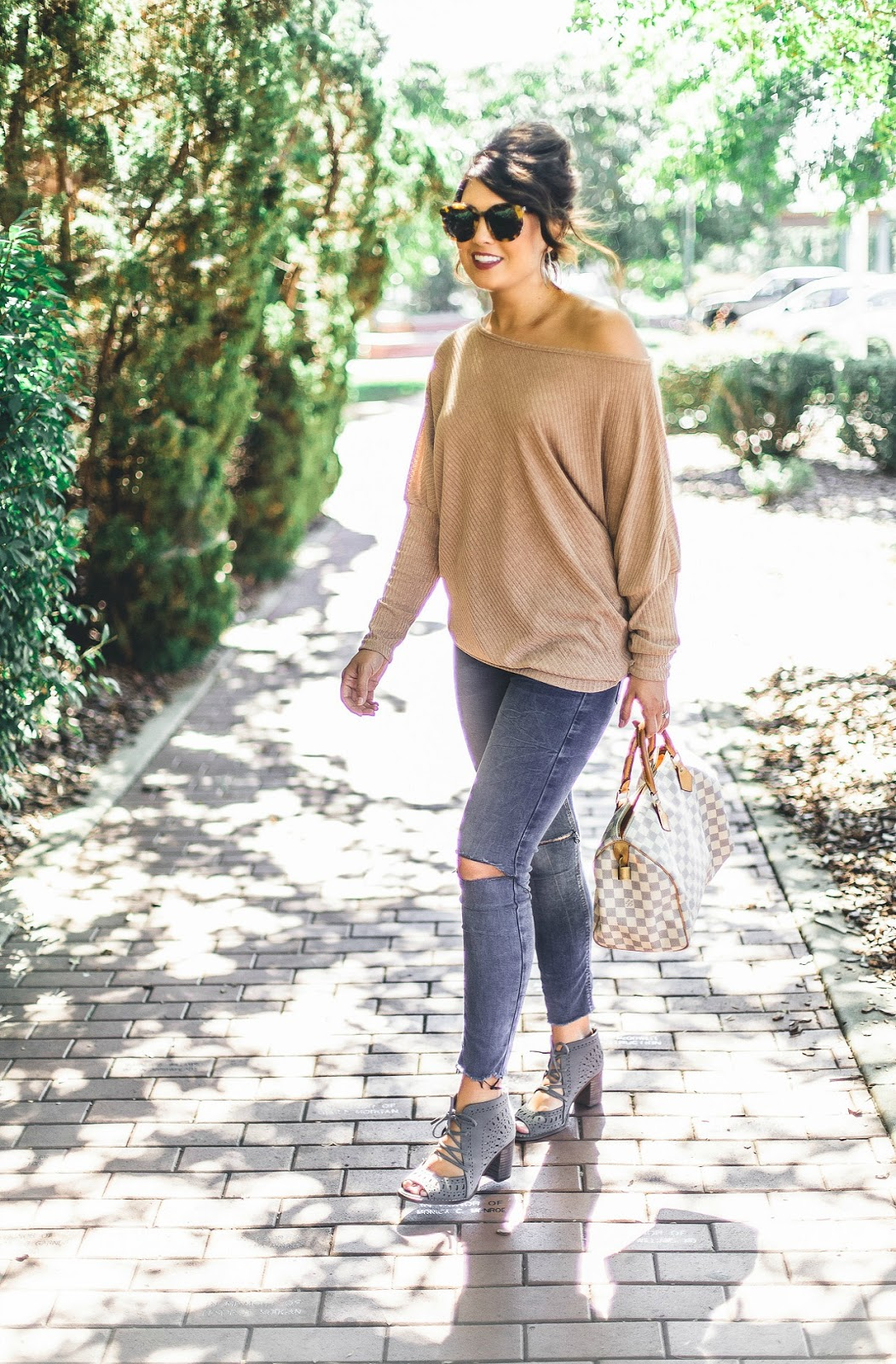 off the shoulder sweater, louis vuitton speedy, short hair updo, karen walker sunglasses