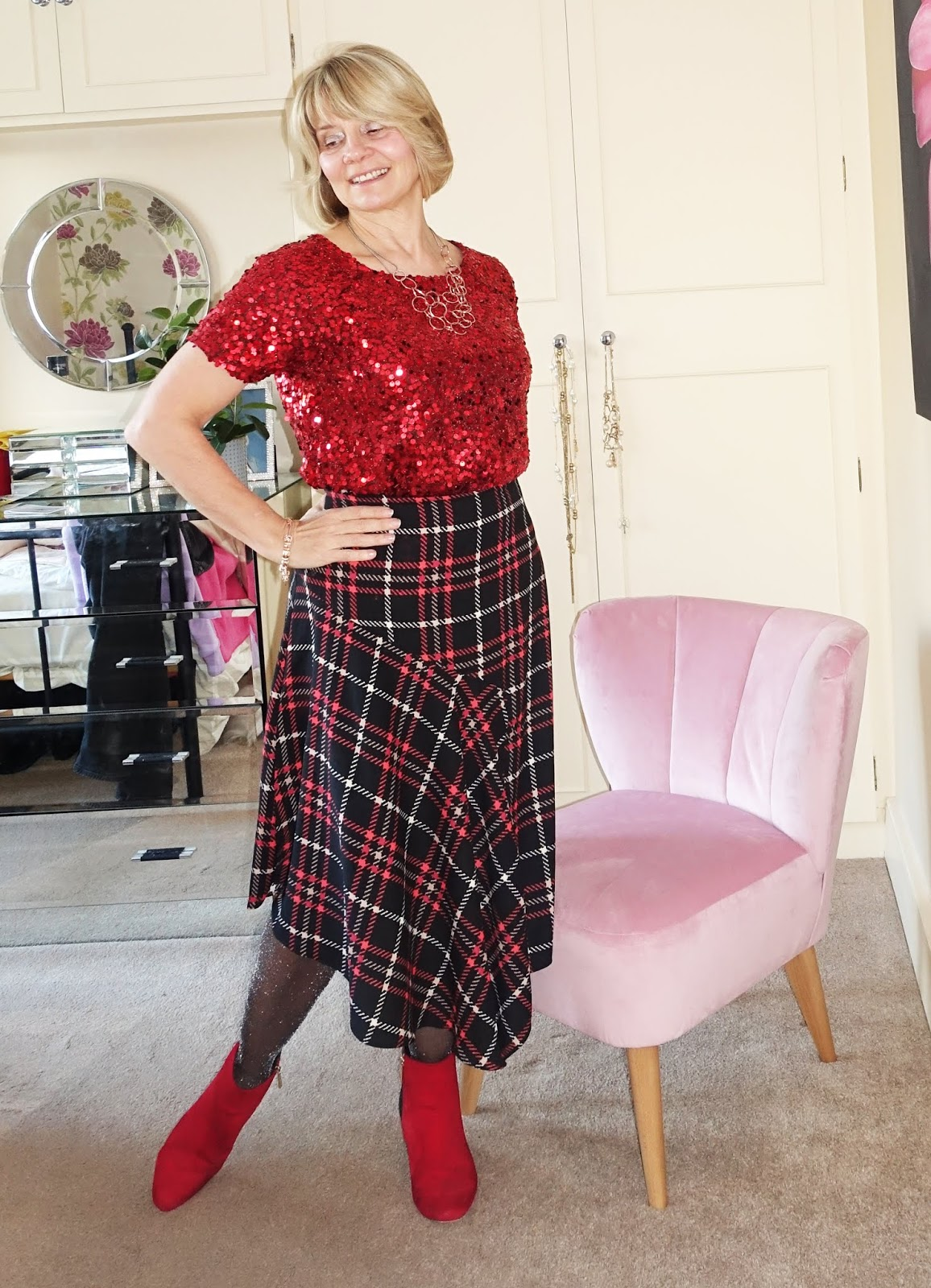 Style blogger Gail Hanlon from Is This Mutton in red sequin top, asymmetric plaid skirt and red and black boots