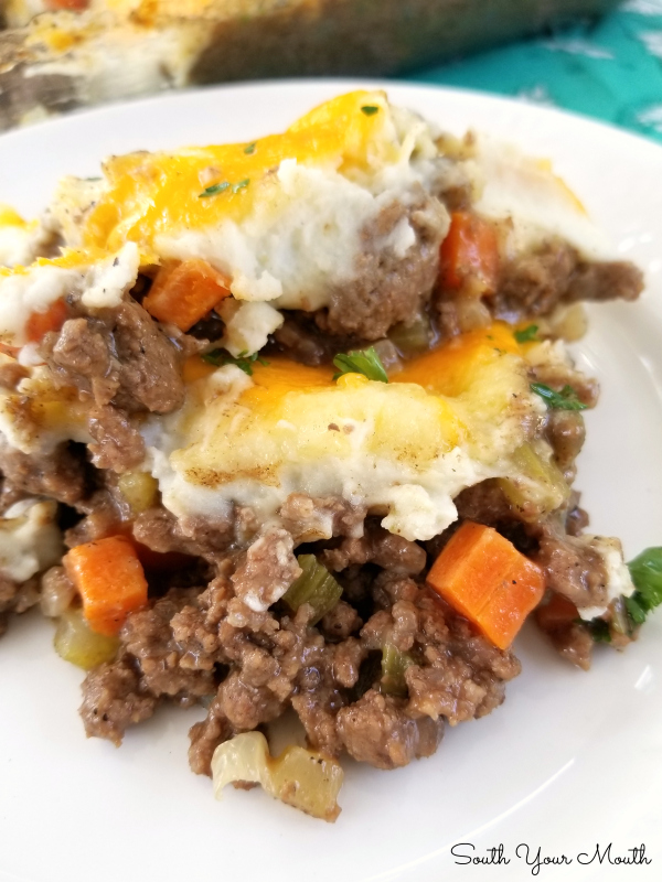 The BEST Shepherd's Pie | A simple but perfect recipe for Shepherd's Pie with a layer of rich meaty gravy on the bottom topped with mashed potatoes and a little cheese.