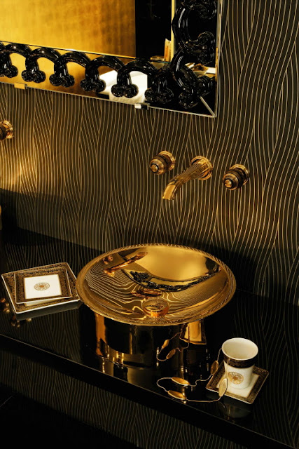 black bathroom with brass decor idea via belle vivir blog
