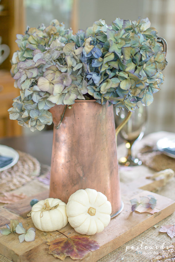dried hydrangeas in a vintage copper pitcher with little white pumpkins