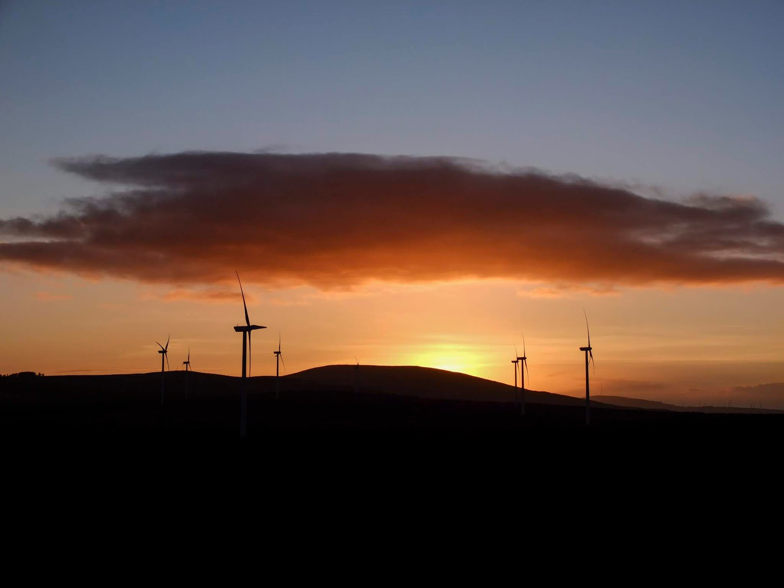 A windmill farm and a mountain sunset in North County Cork.