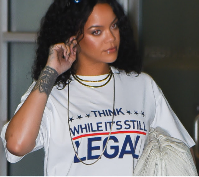 THINK WHILE IT'S STILL LEGAL shirt as worn by Rihanna leaving Chelsea Pier 59 Studio in Manhattan on September 24, 2021 in New York City.  PYGear.com