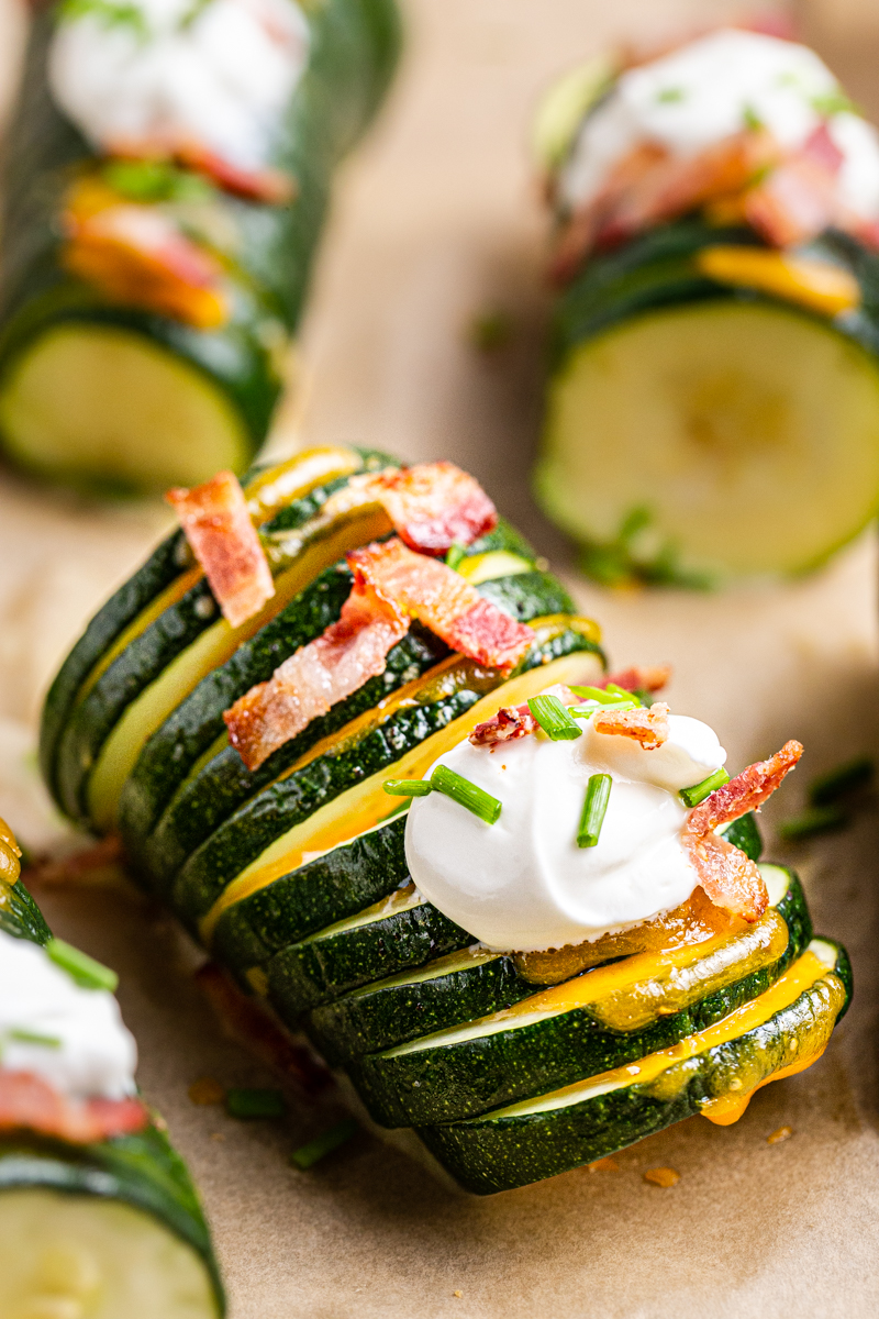 Closeup photo of the cooked Hasselback Zucchini on the baking sheet.