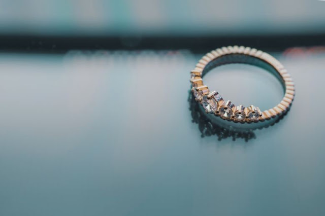 An Engagement Ring On The Table