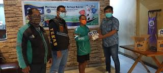 Team Khusus Anti Begal Berbagi Morinaga Chil*go Nutrizi Kepada 1000 Driver Ojol di Makassar.