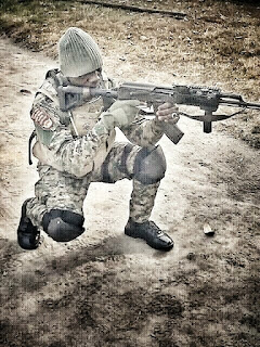a nigerian special force soldier posing with an ak-47 rifle
