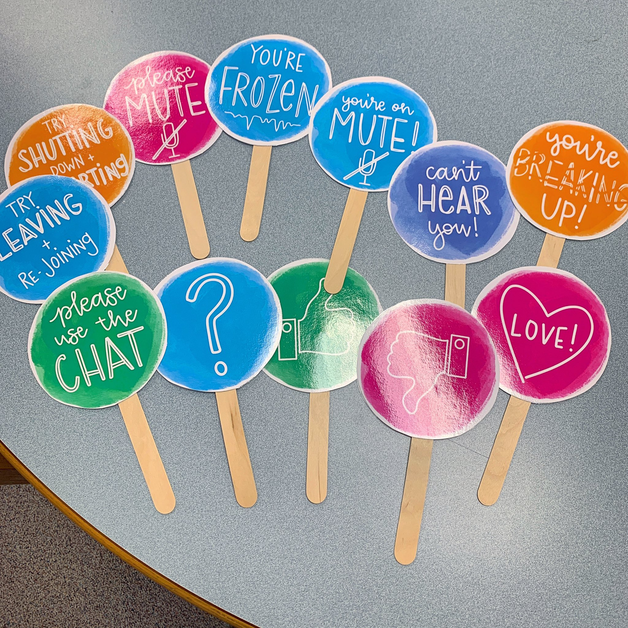 Circular signs printed out and attached to popsicle sticks