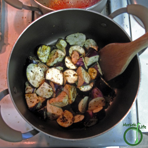 Morsels of Life - Eggplant in Spicy Garlic Sauce Step 4 - Add eggplant, turning as they cook to make sure that all sides are exposed to the flavors.