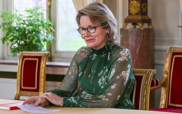 Queen Mathilde wore a floral print lapelless jacket from Giorgio Armani, and a floral print tulle dress from Natan