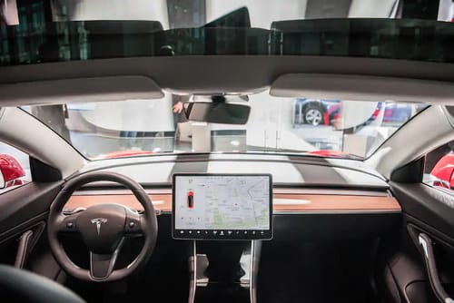Tesla launches plan to enable its cars to self-drive