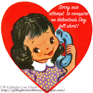 "Vintage valentine in the shape of a red heart. Inside the heart is a girl on the telephone. The upper right corner of the heart says ""Sorry our attempt to conspire on Valentine's Day fell short!"""