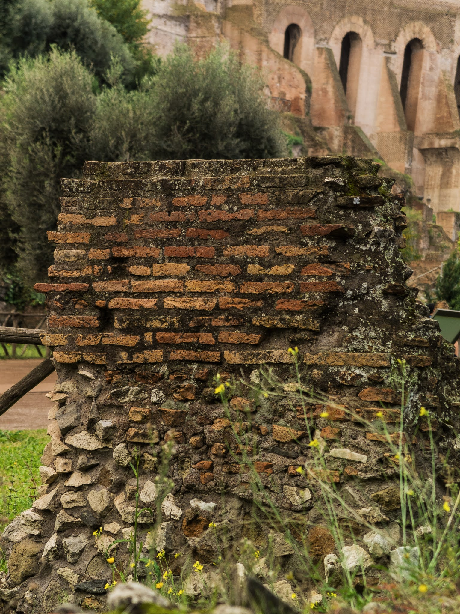 Close up of brick and stone wall remnants of Ancient Rome on Palatine Hill.
