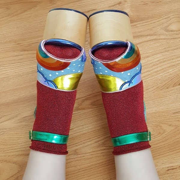wearing large wooden platform sandals with open toe