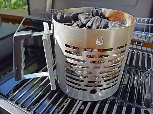 Fire burning on grill grate in Char-Broil Half -Time Chimney Starter