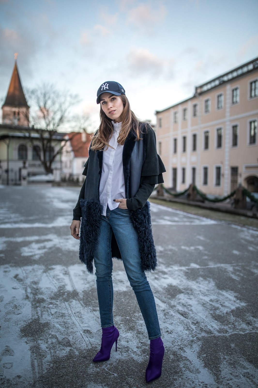 shearling vest jeans sock boots cap outfit winter