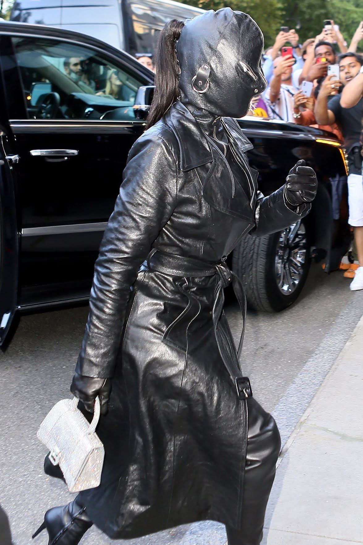 Reality star shocks in fetish mask with zips and head to toe leather look as she arrives in NYC