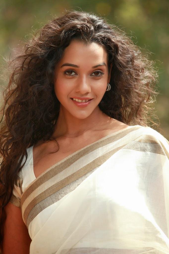 Anu priya latest photos in white saree from potugadu telugu movie