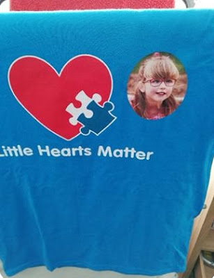 The Little Hearts Matter running vest with a picture of Jessica