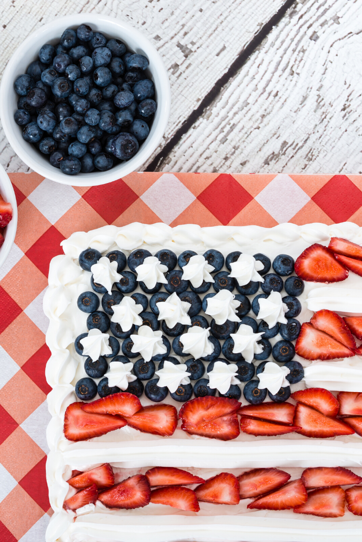 American Flag #Strawberry #Poke #Cake Try this super quick and easy Sugar #Cookie Flag Fruit Pizza for a fun 4th of July or Memorial Day Dessert on gracefullittlehoneybee.com #food #recipes #desserts #dessertrecipes #easydesserts #foodlovers #cakerecipes #cakesrecipes #cake #cakes #recipes