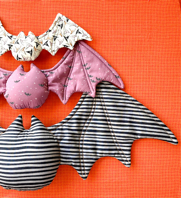 Halloween bats in 3 sizes on orange backround