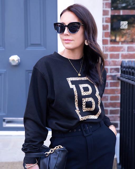 woman in black sweatshirt