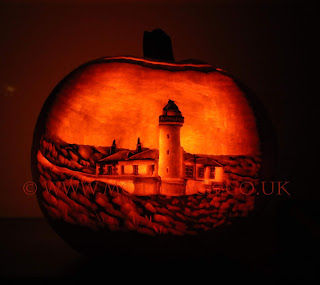 A photo of a pumpkin carving of a lighthouse on the Isle of May.