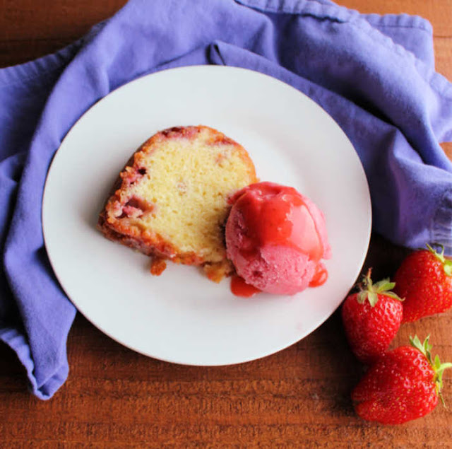 slice of strawberry and cream bundt cake with scoop of strawberry sherbet