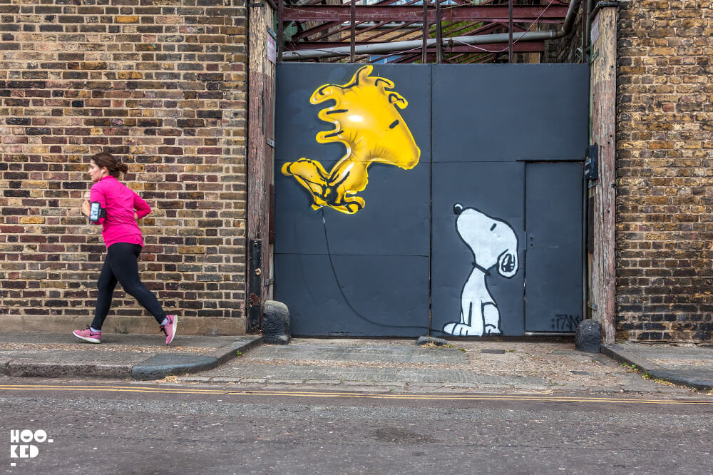 England - Snoopy Inspired Mural in Haggerston, London painted by street artist Fanakapan.
